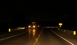 Truck-across-road-in-dark